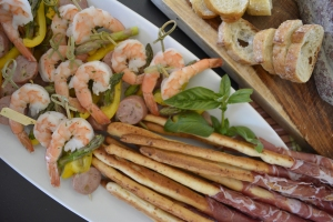 Shrimp Skewers and Prosciutto wrapped breadsticks.